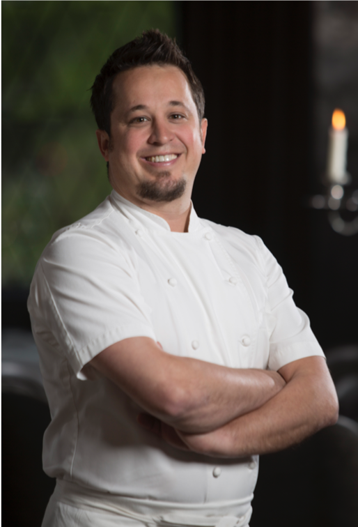 "A Long Island native, Chef Danny Grant began cooking at a young age with his family in Scottsdale, Arizona. He moved to Chicago in his early twenties and began cooking for 2003 Food & Wine Best New Chef, Bruce Sherman, at North Pond. After four years as a sous chef at North Pond, Chef Grant left to cook abroad in Paris and attend The French Pastry School to round out his skills. He later came back to Chicago to serve as sous chef for NoMI Restaurant.  Chef Grant's classic French training and forward-thinking vision work in concert to consistently turn out elegant dishes with sharply focused flavors. His career dropped into high gear in 2009, when he became executive chef for RIA and Balsan Restaurants at the former Elysian Hotel, where his respective French and European bistro menus earned him  Food & Wine's  ""2012 Best New Chef"" award. Chef Grant was the youngest US Chef to earn two Michelin stars in both 2011 and 2012 at RIA. While there, he also earned perfect four-star reviews from the Chicago Tribune and Chicago magazine.  In 2015, he joined What If…Syndicate. Now, the award-winning portfolio of brands – Maple & Ash, Mavens & Aficionados, 8 Bar, etta, and Aya Pastry – are the center of a growing hospitality group. Chef Grant always encourages a fun, lively atmosphere in both the kitchen and the dining room and is often found mingling with guests throughout dinner service.  Danny applies the same enthusiasm and zest in his family life--when he is not cooking, you can find him either playing nerf guns with his son Dean or out eating pasta with his daughter Delilah."