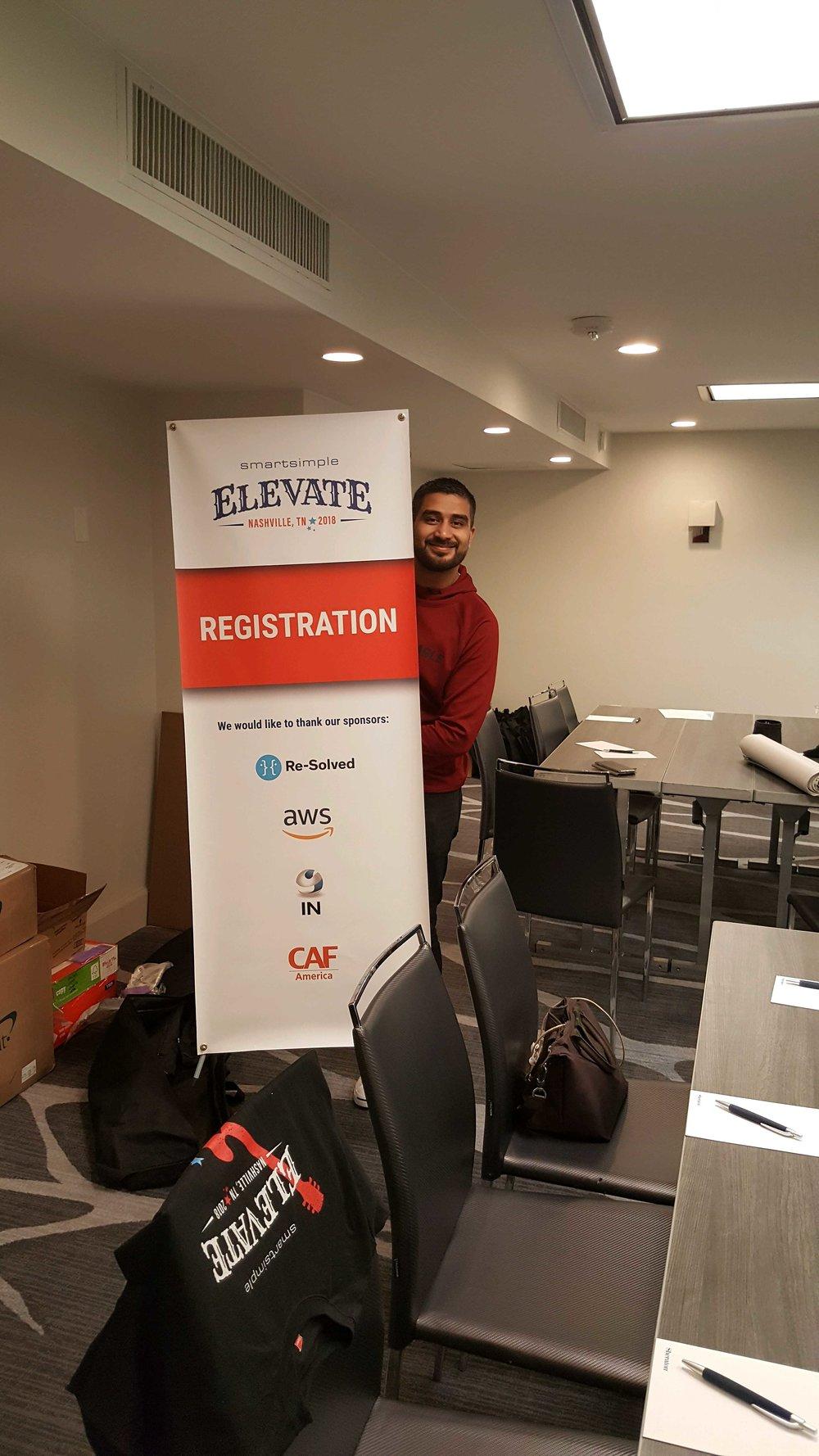SmartSimple's Team Lead of Technical Community Support, Arjun Hiranandani, setting up for Elevate
