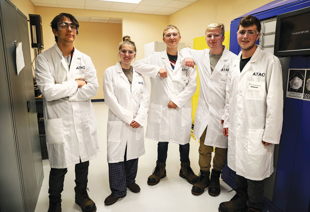 Photo by Cheryl Senter. Spaulding High School students preparing at Great Bay Community College for careers in advanced manufacturing.