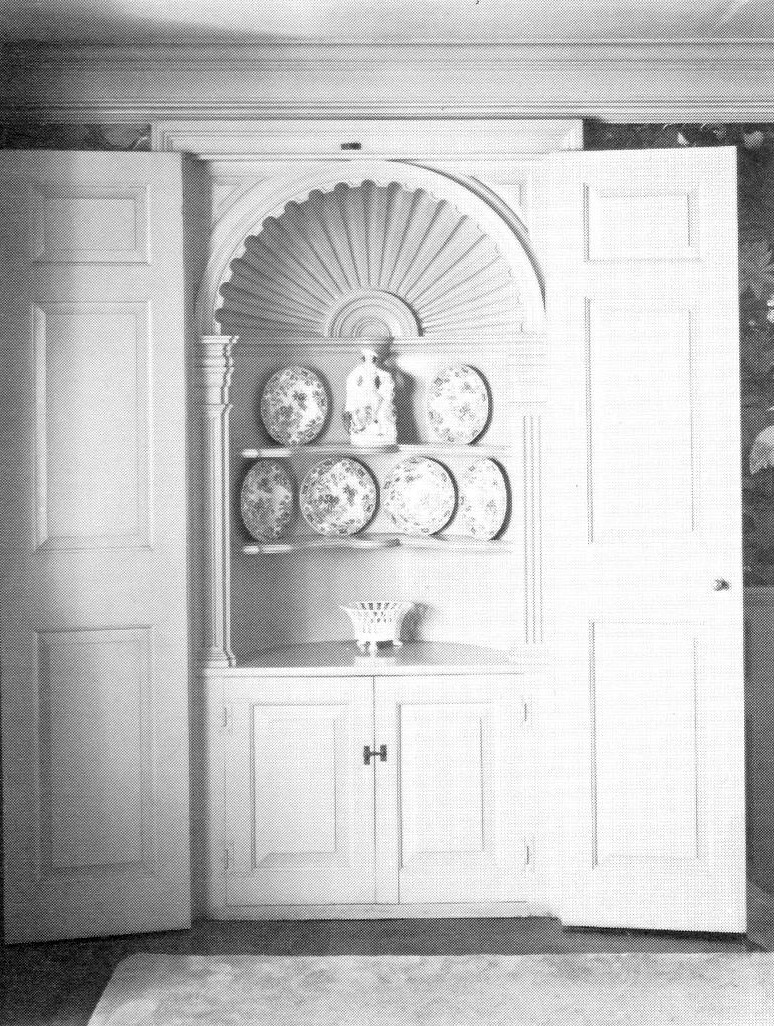 Hand carved shell top cabinet, 1927. Featured in  Aurora's Architectural Heritage.