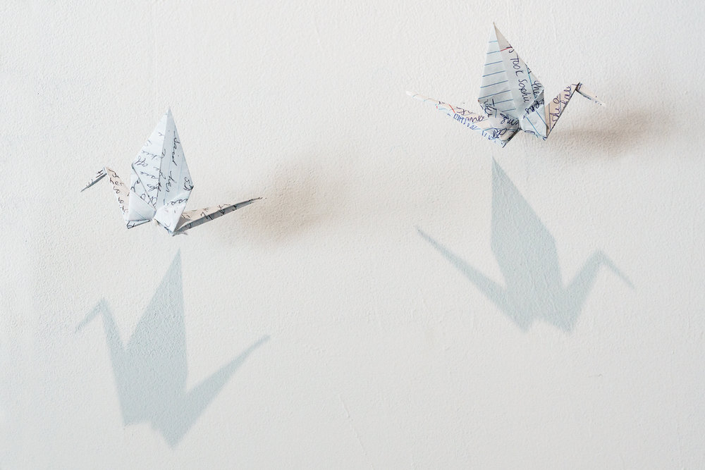 Origami cranes from notebook pages