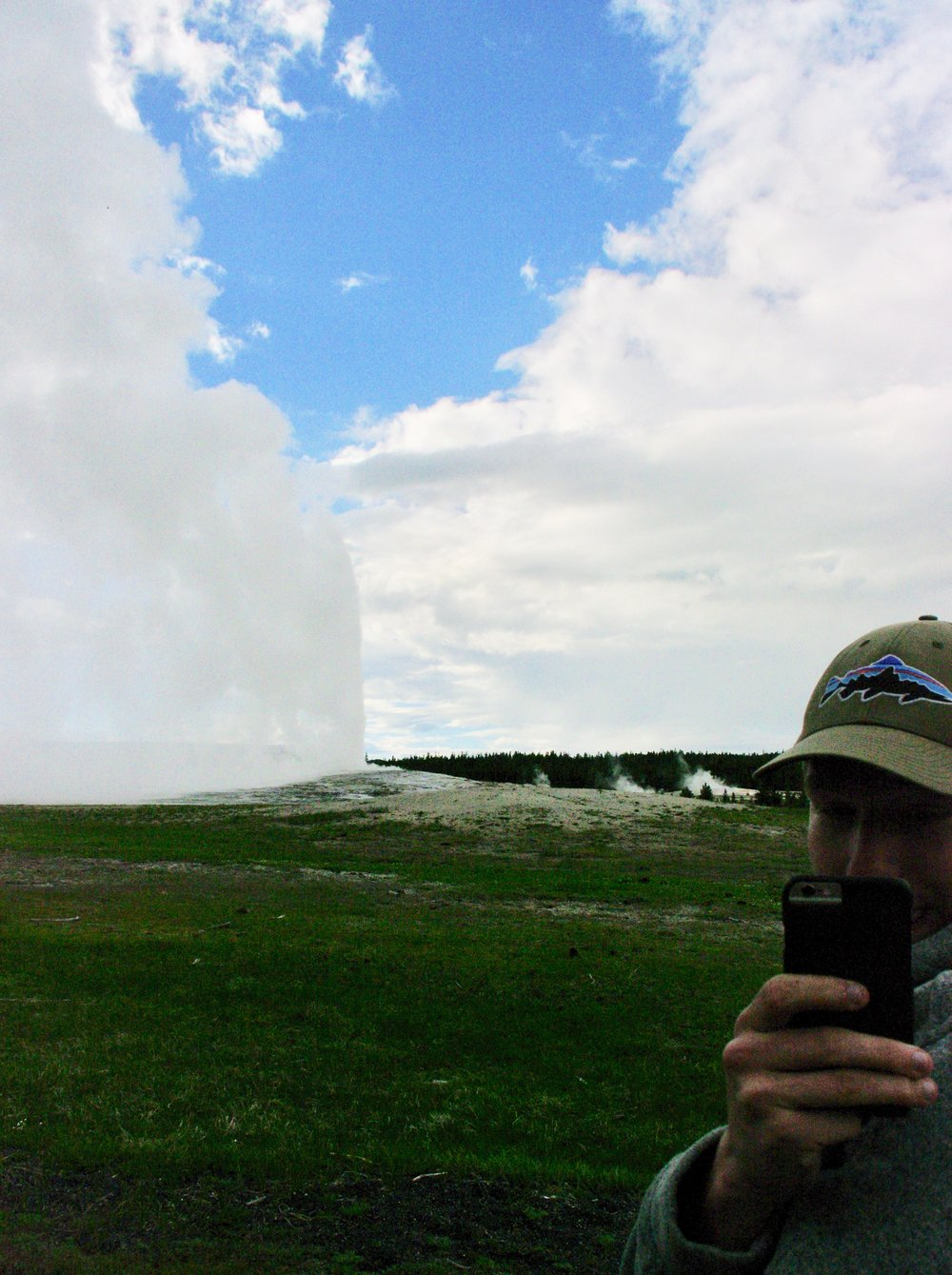 Ike taking a picture of me taking a picture of Old Faithful