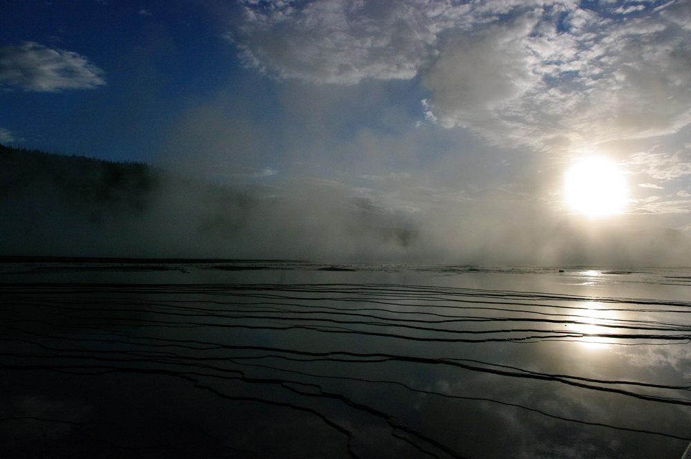 Sun setting over the Grand Prismatic Spring