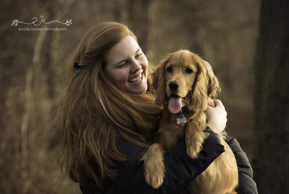 Outdoor pet photoshoot of owner cuddling golden spaniel puppy.jpg