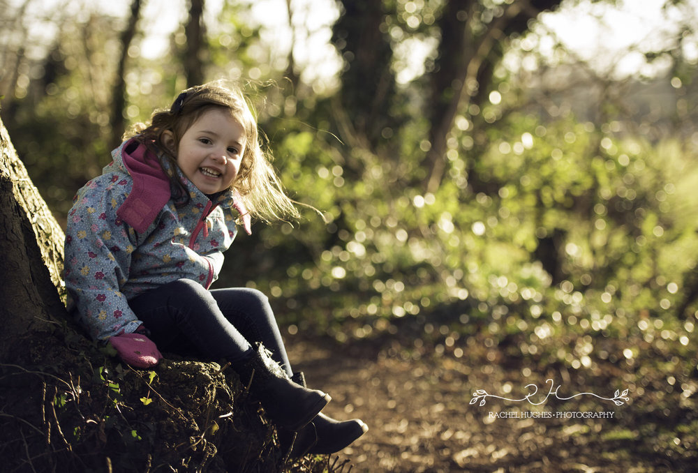 Girl laughing in woodland