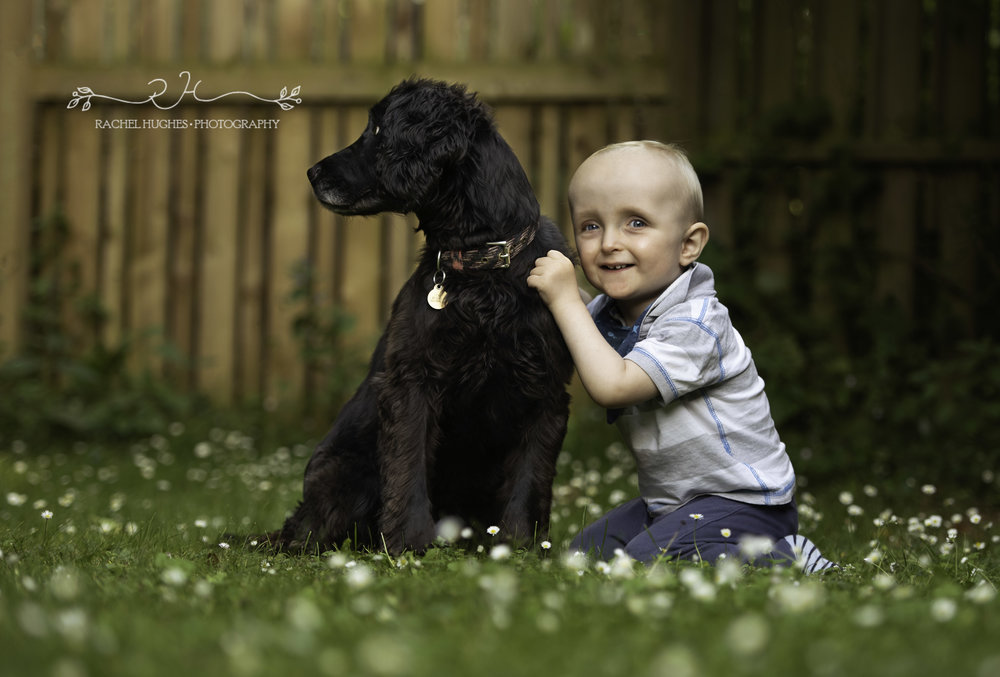 Boy and dog in garden family photography Henley-on-Thames