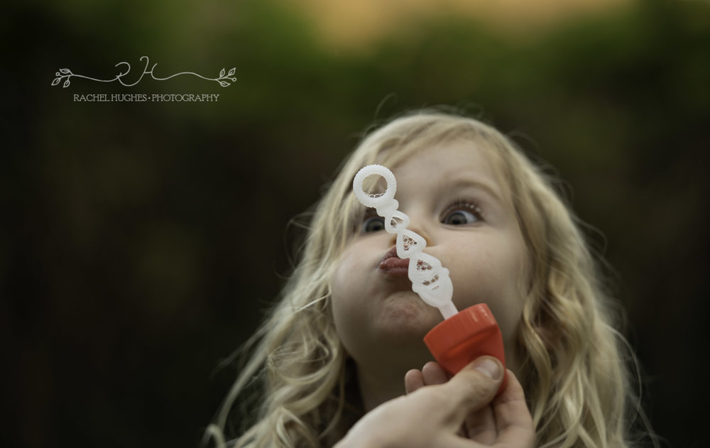 Girl blowing bubbles family photographer Henley-on-Thames