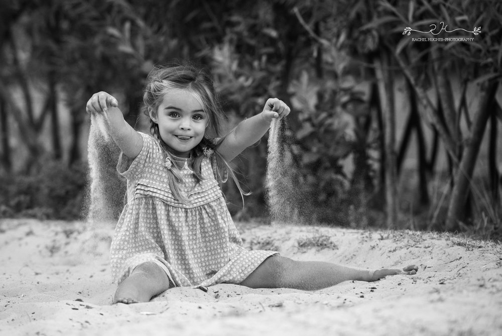Jersey photographer - girl playing in sand