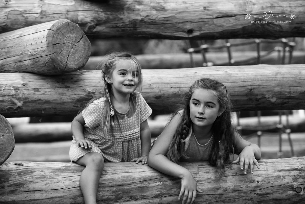 Jersey photographer - sisters playing in park