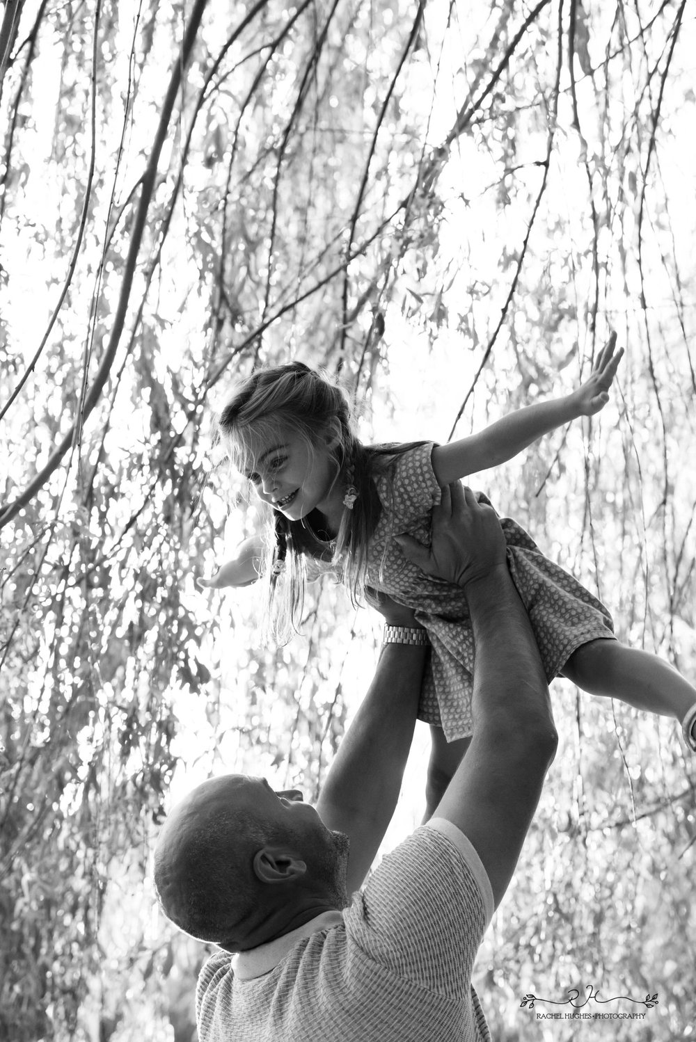 Jersey photographer - girl flying in Daddy's arms