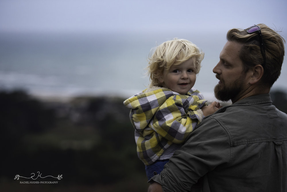 Jersey photographer - boy in dad's arms in storm