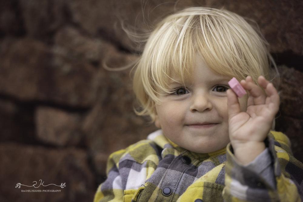 Jersey photographer - boy holding a sweet