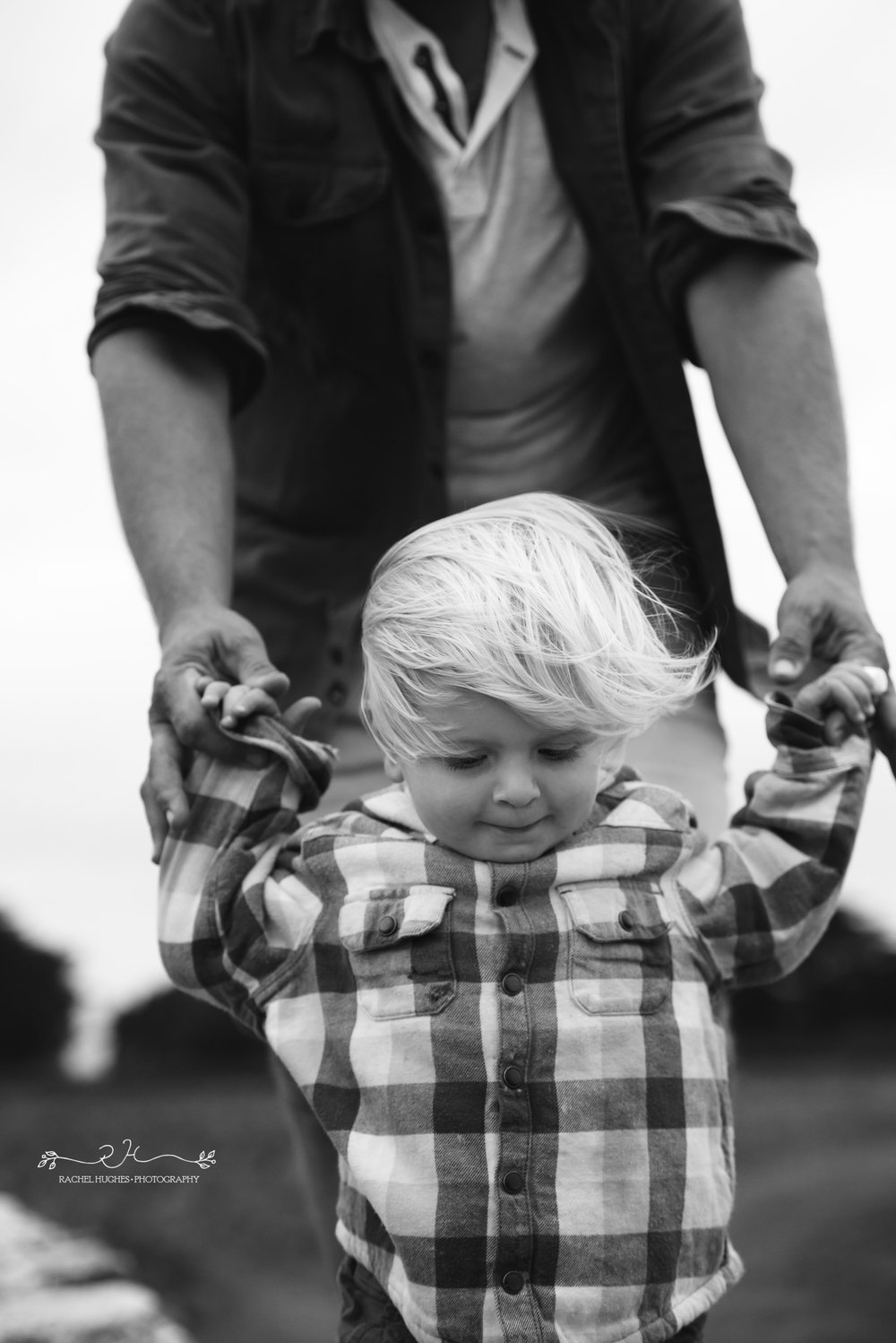 Jersey photographer - boy balancing on wall with dad at Grantez