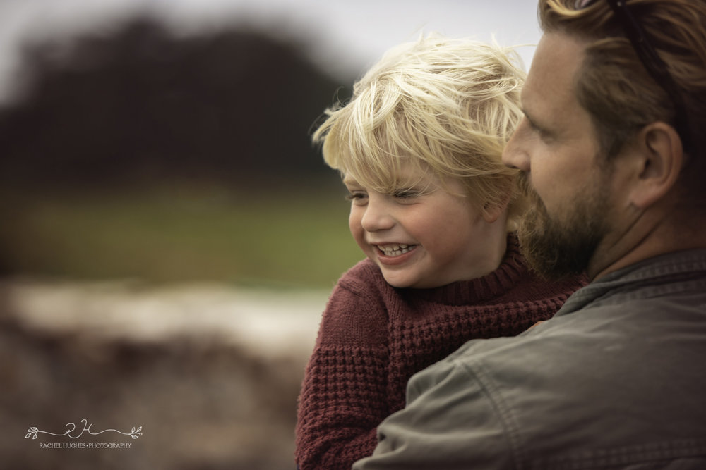 Jersey photographer - boy being held in storm by Dad
