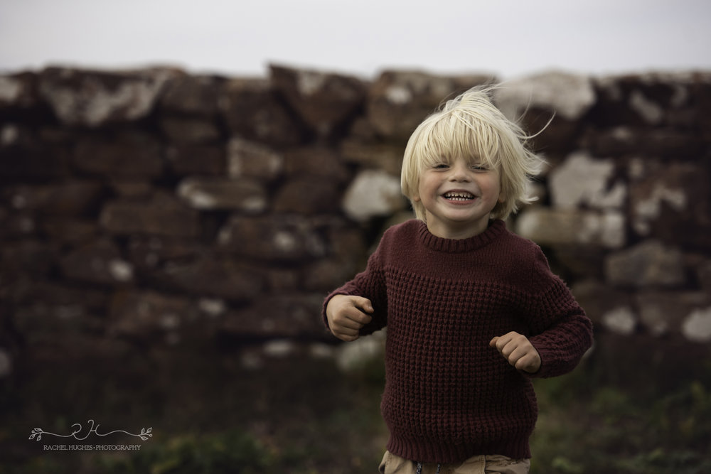 Jersey photographer - boy playing in the wind at Grantez