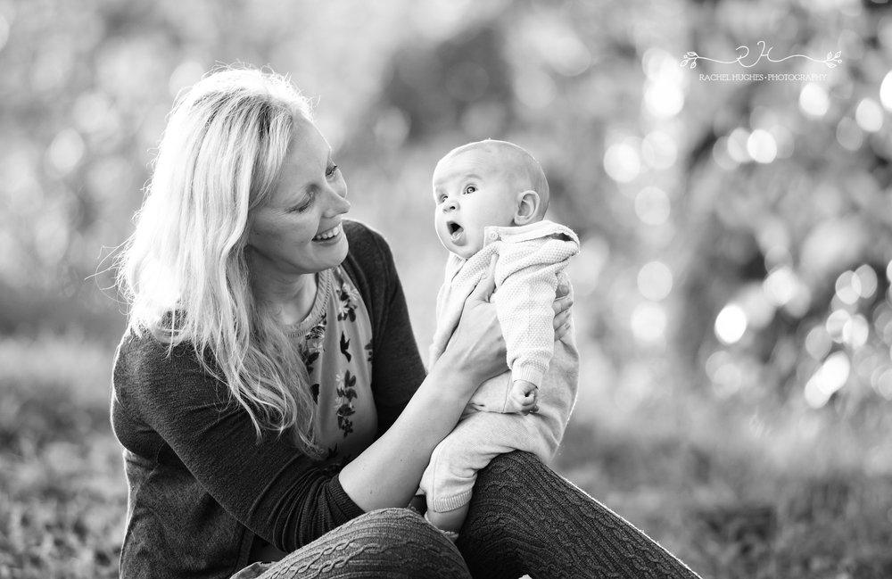 Jersey photographer - baby on Mum's lap at sunset