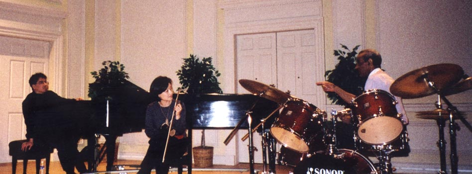 Jiebing and the Beijing Trio. Pictured here is Jon Jang (left), Jiebing Chen (center), and Max Roach (right).