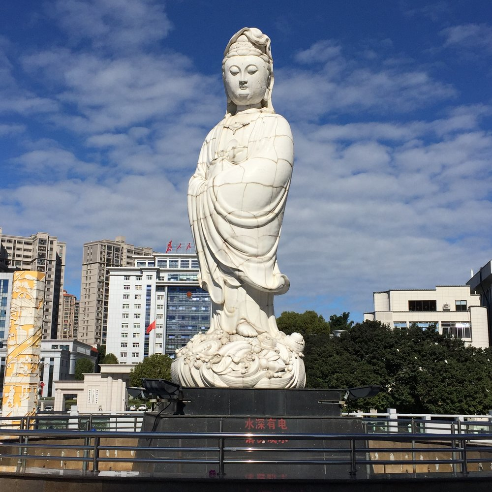 Guanyin statue that stands by the Chanxi River, Dehua