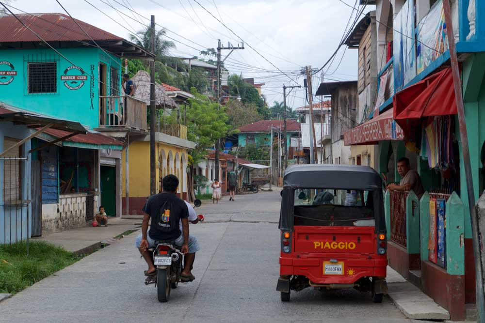 The colorful look of Utila and a classic tuk-tuk