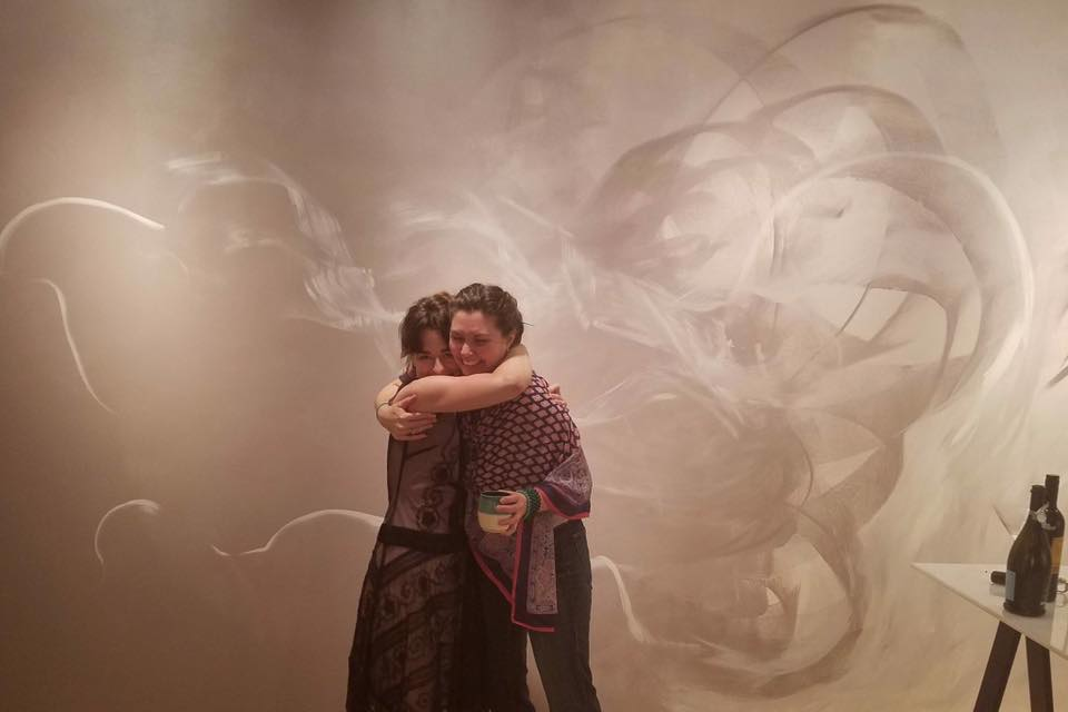 Samantha Buker & Jordan Faye Block celebrating the Finissage for Jordan Faye Contemporary. July 2017. Mural behind them,  Intuitive Enigma , by Ms. Block.
