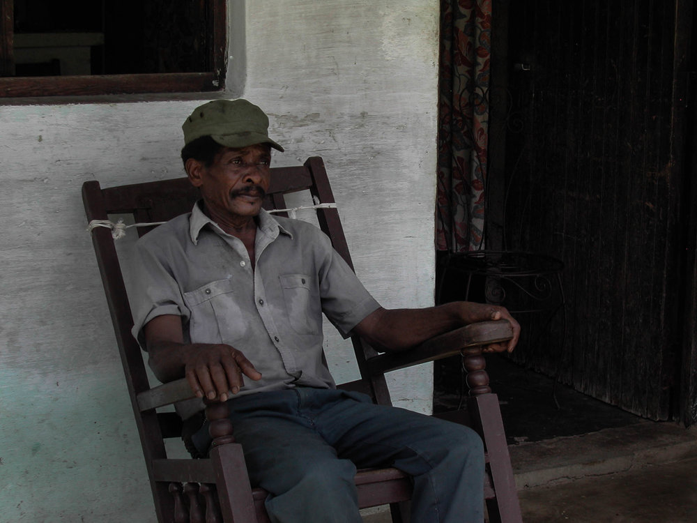 Feliciano_front porch in rocking chair.jpg