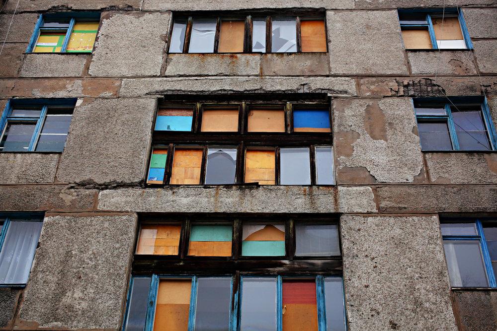 Boarded Up Windows in Donetsk, Ukraine, 2016. Photograpyh by Dimitri Beliakov