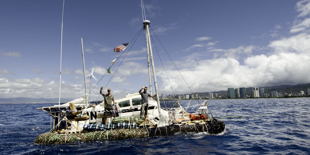 Marcus Eriksen and Joel Paschal assembled a raft out of 15,000 plastic bottles, part of an airplane fuselage, a few recycled shipping masts, and other rubbish before setting off on a three-month voyage (Image: Supplied)