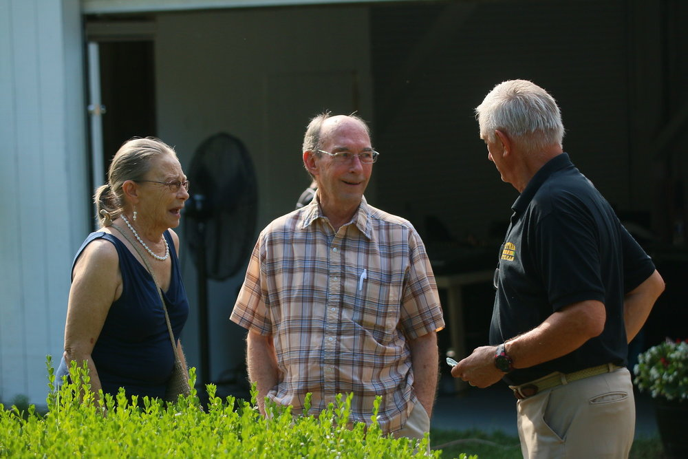 Heroes Center Founder and President, Bob Uber, speaks with Mr. and Mrs. Ron Wimberly, Heroes Center Sponsors