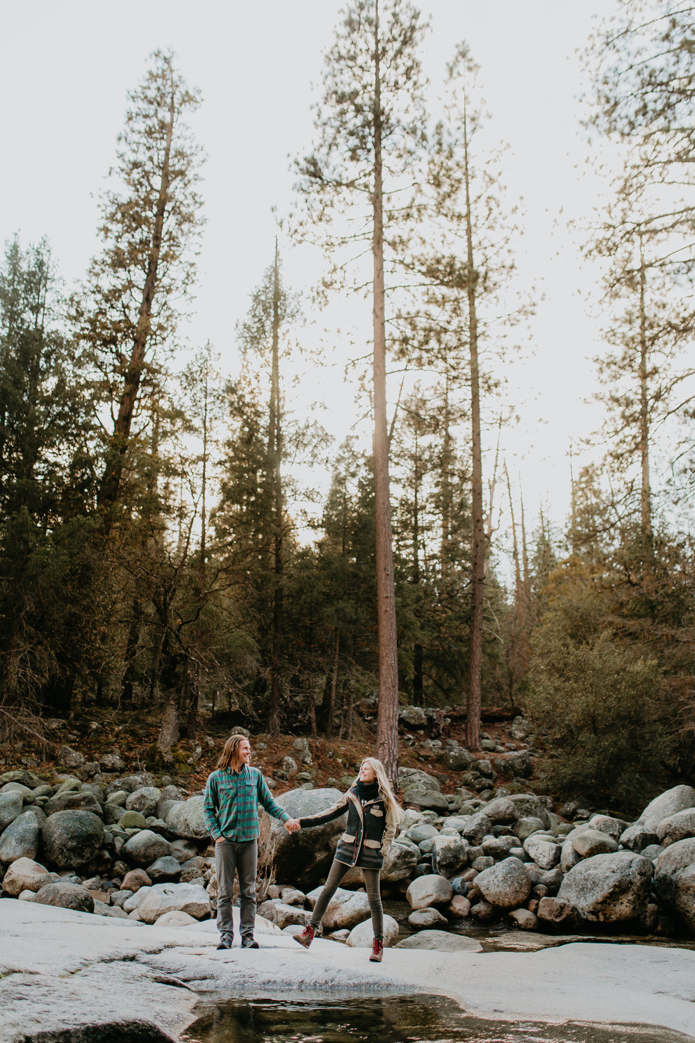 nicole-daacke-photography-yosemite-riverside-adventurous-engagement-photos-in-yosemite-national-park-elopement-photographer-weddings-travel-destination-wedding-eloping-elope-pine-forest-9.jpg