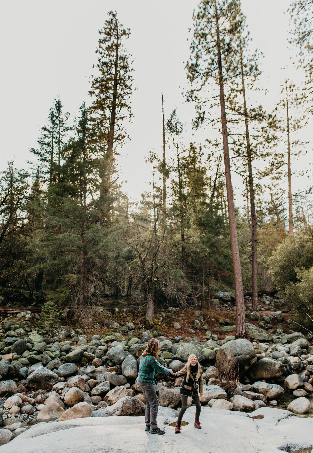nicole-daacke-photography-yosemite-riverside-adventurous-engagement-photos-in-yosemite-national-park-elopement-photographer-weddings-travel-destination-wedding-eloping-elope-pine-forest-17.jpg