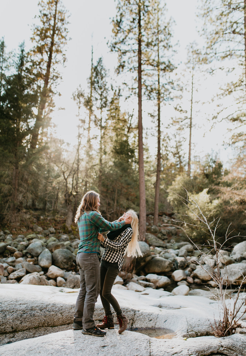 nicole-daacke-photography-yosemite-riverside-adventurous-engagement-photos-in-yosemite-national-park-elopement-photographer-weddings-travel-destination-wedding-eloping-elope-pine-forest-23.jpg