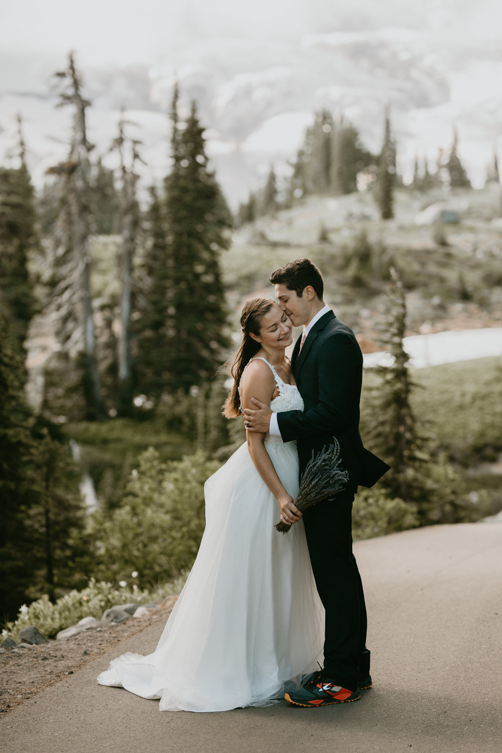 Nicole-Daacke-Photography-Mt-Rainier-elopement-photographer-washington-mountain-epic-wedding-photography-wildflowers-at-rainier-pine-tree-cloudy-summer-day-at-mountain-rainier-1.jpg