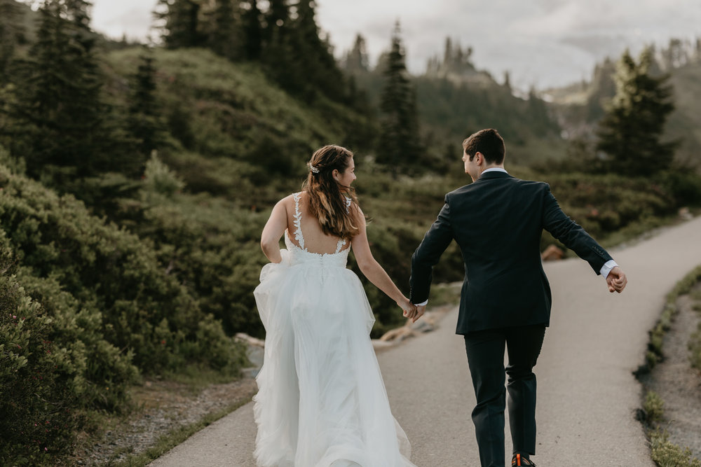 Nicole-Daacke-Photography-Mt-Rainier-elopement-photographer-washington-mountain-epic-wedding-photography-wildflowers-at-rainier-pine-tree-cloudy-summer-day-at-mountain-rainier-6.jpg