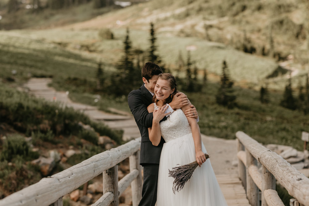 Nicole-Daacke-Photography-Mt-Rainier-elopement-photographer-washington-mountain-epic-wedding-photography-wildflowers-at-rainier-pine-tree-cloudy-summer-day-at-mountain-rainier-14.jpg