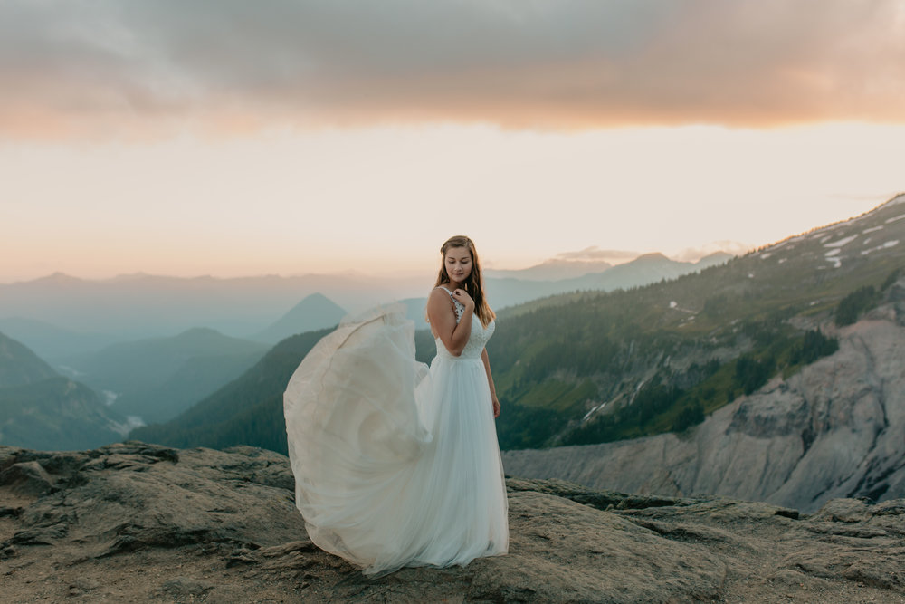 Nicole-Daacke-Photography-Mt-Rainier-elopement-photographer-washington-mountain-epic-wedding-photography-wildflowers-at-rainier-pine-tree-cloudy-summer-day-at-mountain-rainier-51.jpg