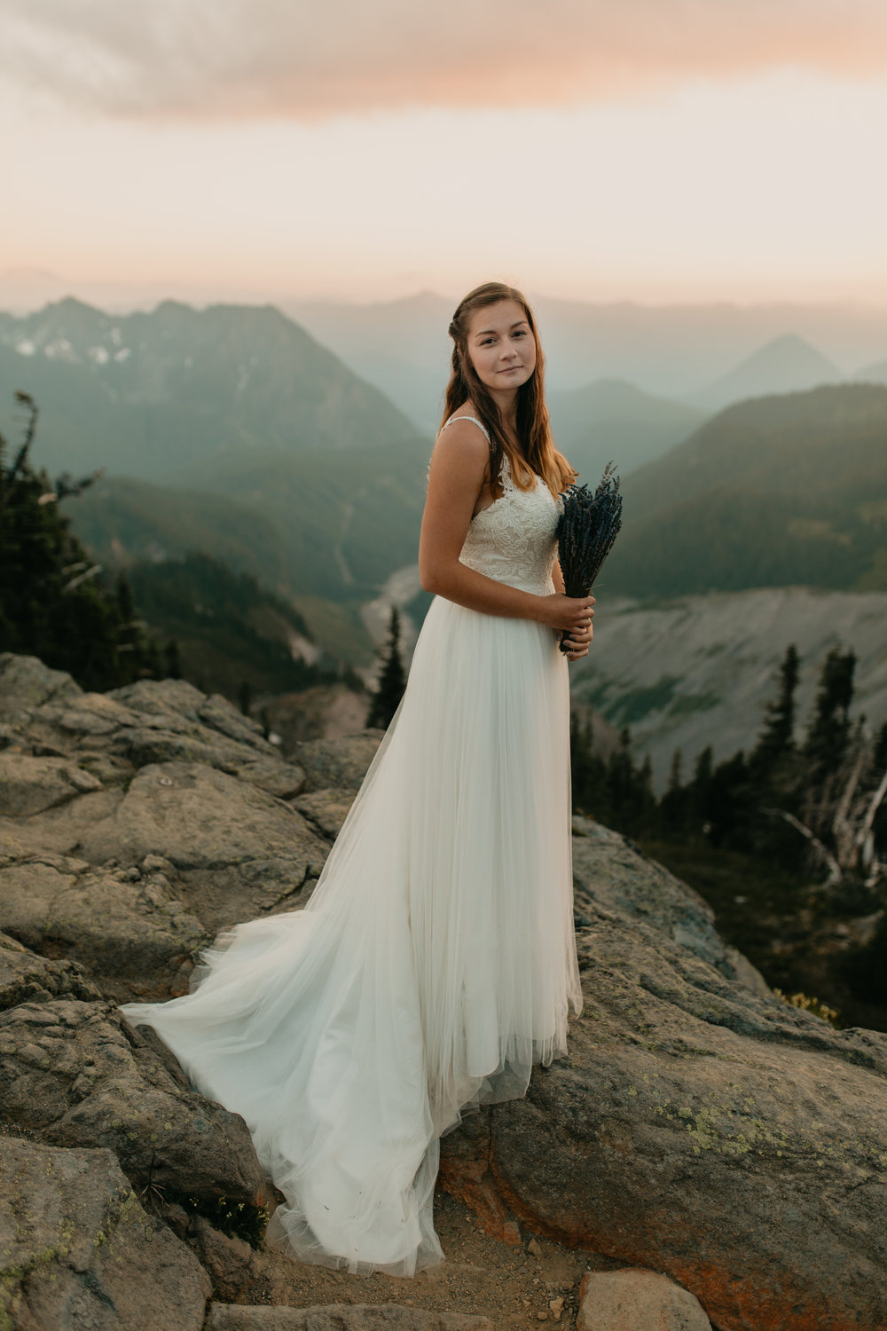 Nicole-Daacke-Photography-Mt-Rainier-elopement-photographer-washington-mountain-epic-wedding-photography-wildflowers-at-rainier-pine-tree-cloudy-summer-day-at-mountain-rainier-52.jpg