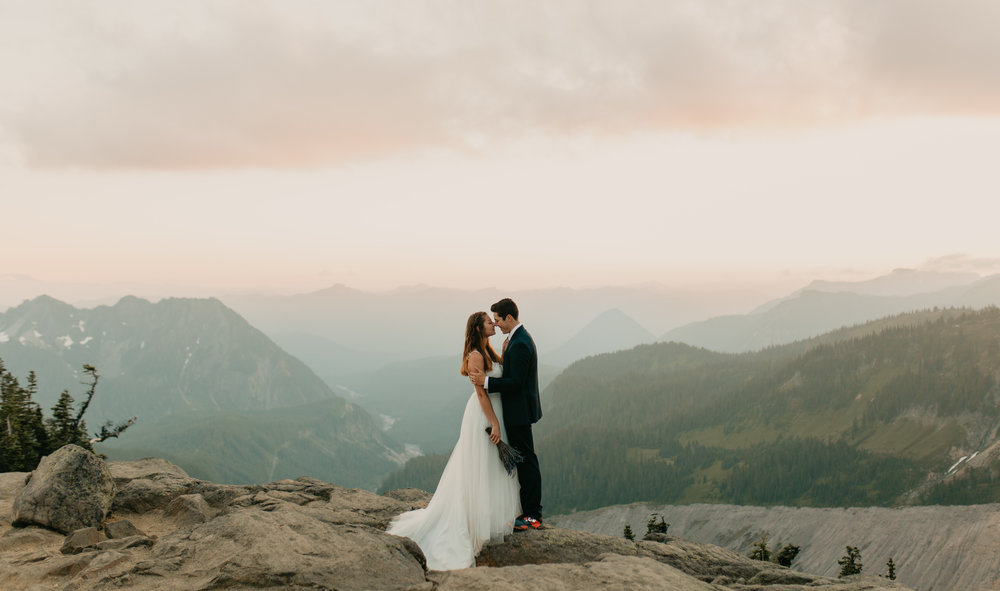 Nicole-Daacke-Photography-Mt-Rainier-elopement-photographer-washington-mountain-epic-wedding-photography-wildflowers-at-rainier-pine-tree-cloudy-summer-day-at-mountain-rainier-54.jpg