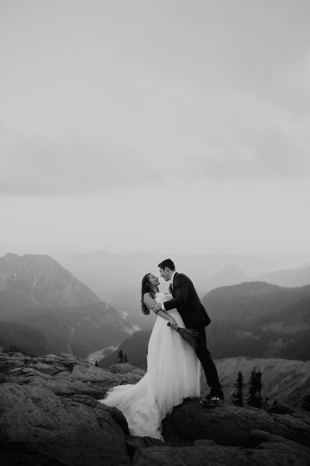 Nicole-Daacke-Photography-Mt-Rainier-elopement-photographer-washington-mountain-epic-wedding-photography-wildflowers-at-rainier-pine-tree-cloudy-summer-day-at-mountain-rainier-55.jpg