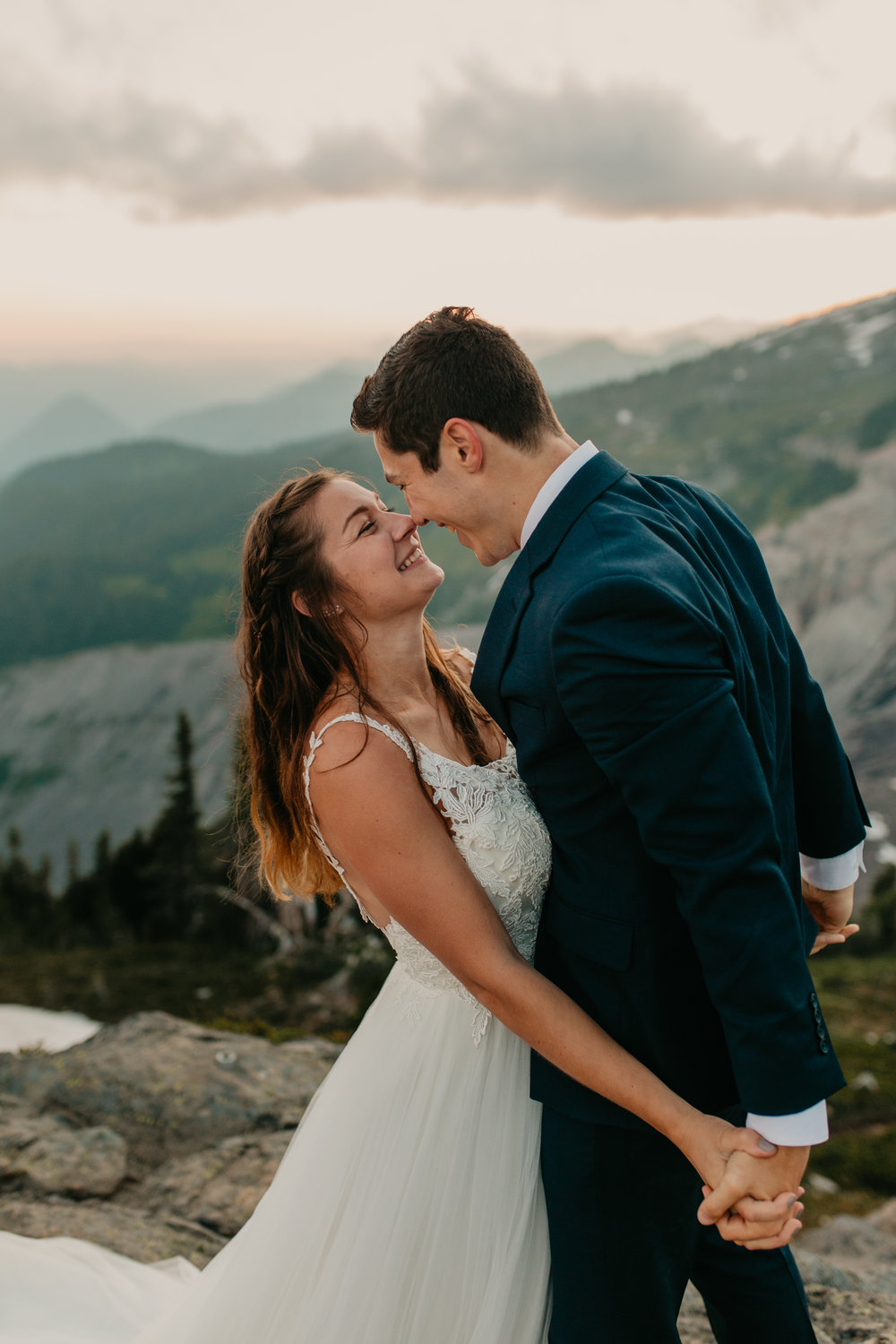 Nicole-Daacke-Photography-Mt-Rainier-elopement-photographer-washington-mountain-epic-wedding-photography-wildflowers-at-rainier-pine-tree-cloudy-summer-day-at-mountain-rainier-63.jpg