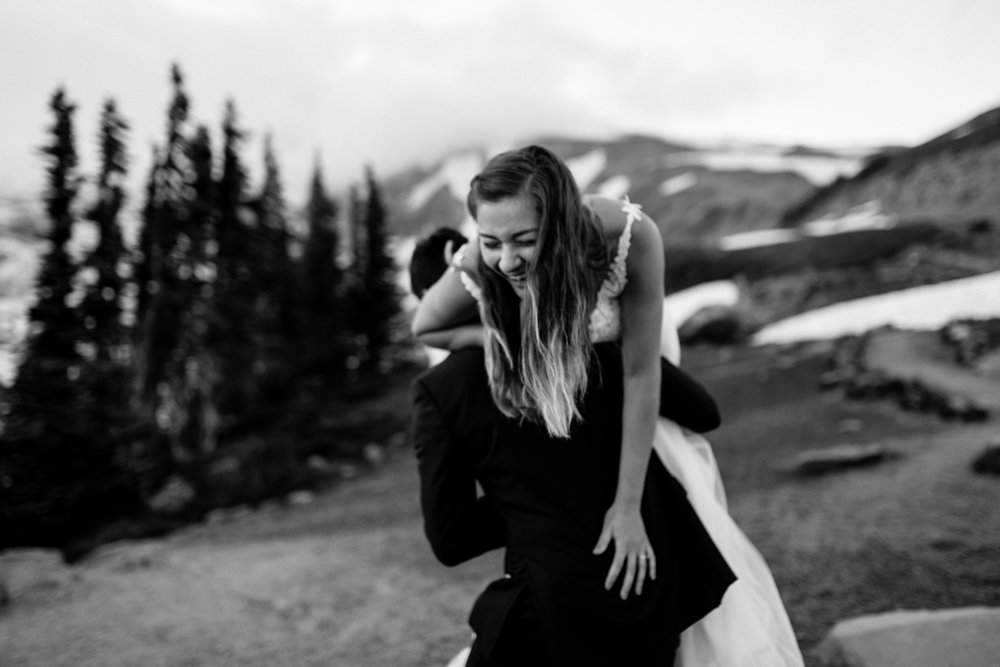 Nicole-Daacke-Photography-Mt-Rainier-elopement-photographer-washington-mountain-epic-wedding-photography-wildflowers-at-rainier-pine-tree-cloudy-summer-day-at-mountain-rainier-67.jpg