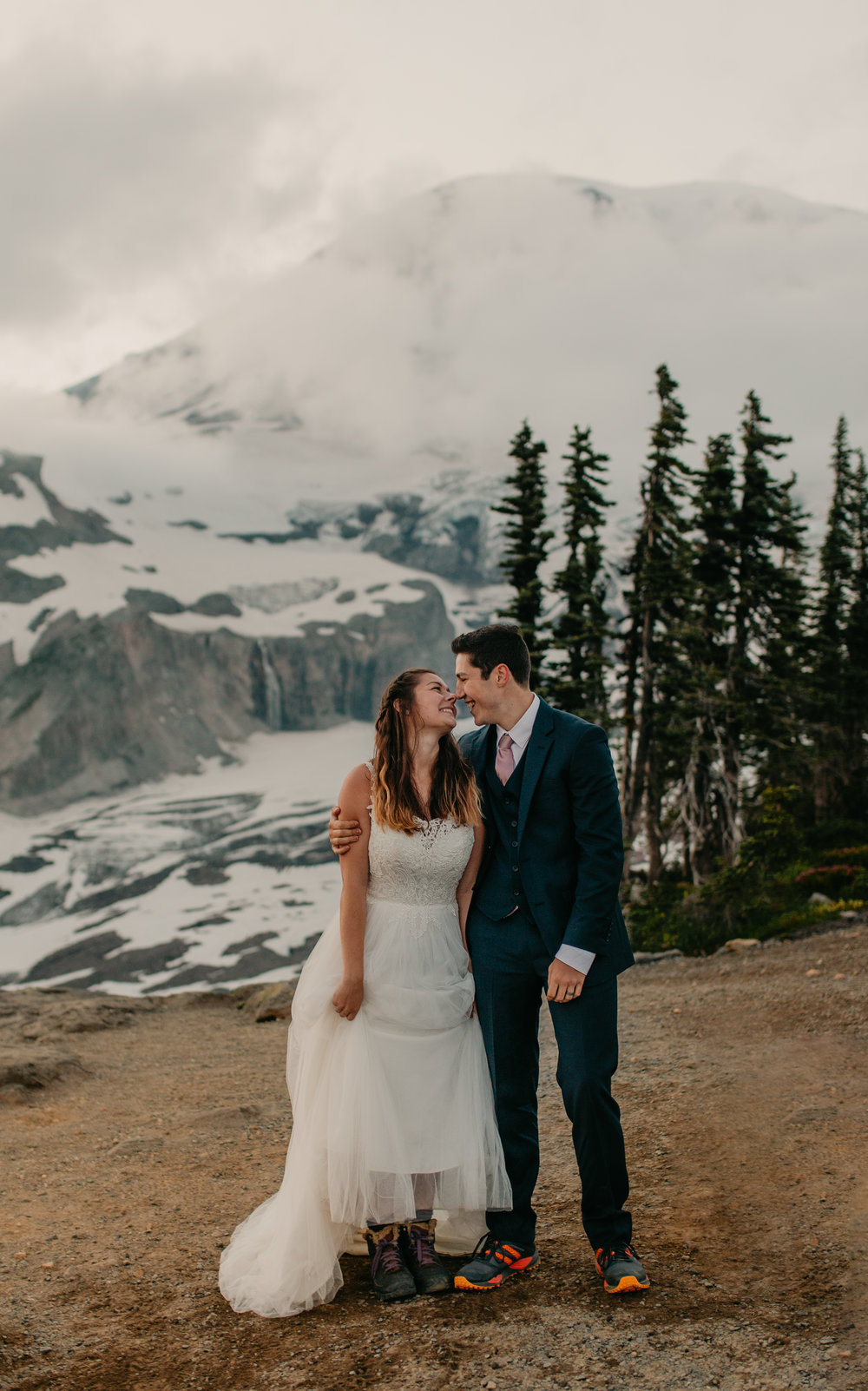 Nicole-Daacke-Photography-Mt-Rainier-elopement-photographer-washington-mountain-epic-wedding-photography-wildflowers-at-rainier-pine-tree-cloudy-summer-day-at-mountain-rainier-69.jpg