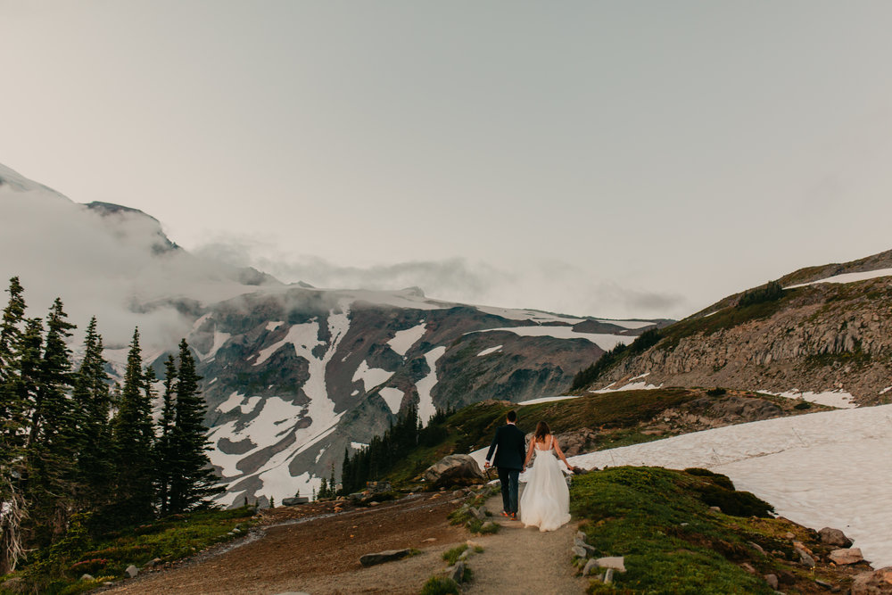 Nicole-Daacke-Photography-Mt-Rainier-elopement-photographer-washington-mountain-epic-wedding-photography-wildflowers-at-rainier-pine-tree-cloudy-summer-day-at-mountain-rainier-71.jpg