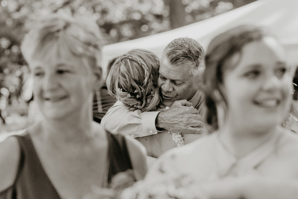 Nicole-Daacke-Photography-pennsylvania-laid-back-outside-backyard-wedding-family-summer-june-maryland-barefoot-bride-woodland-trees-sunset-couple-49.jpg