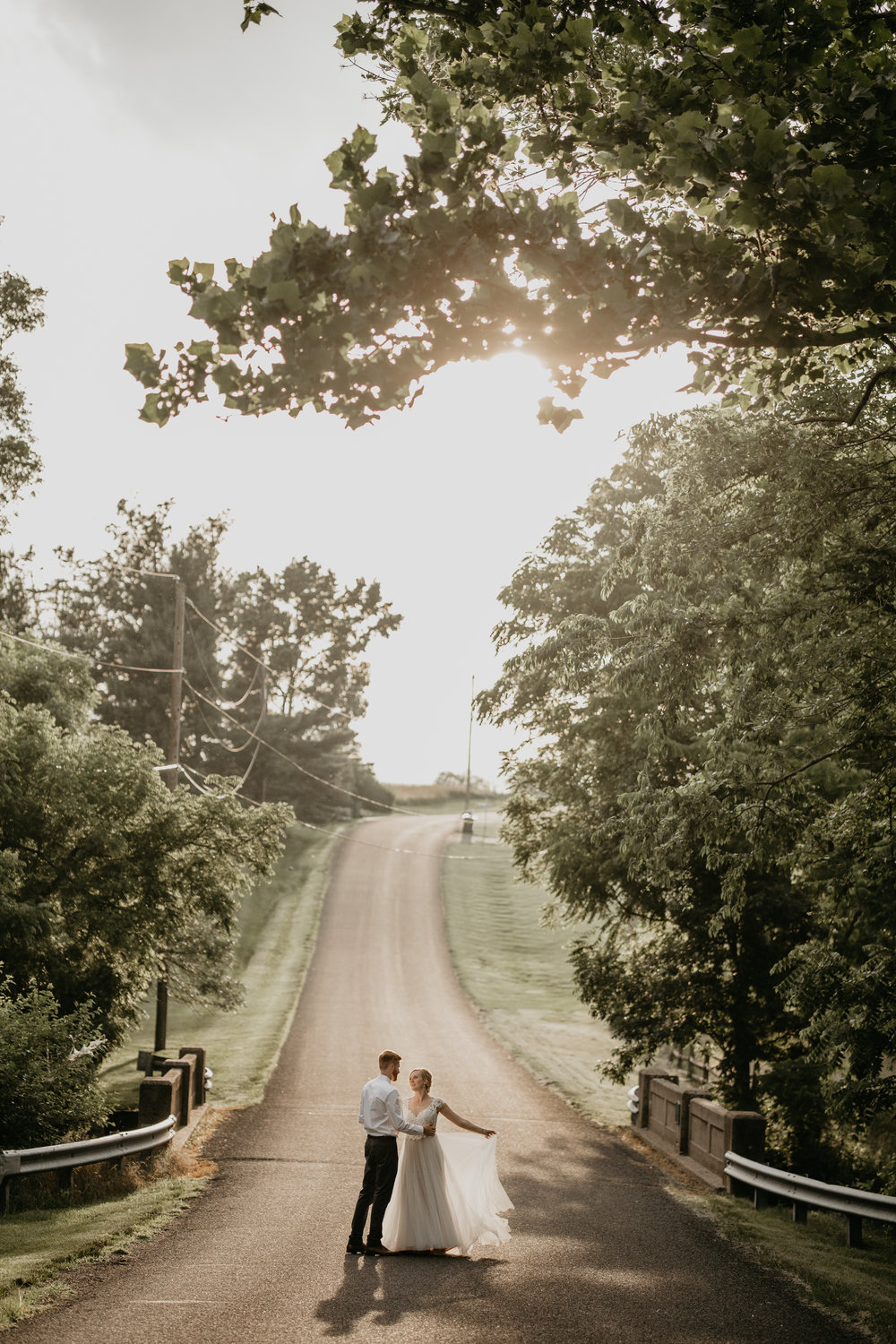 Nicole-Daacke-Photography-pennsylvania-laid-back-outside-backyard-wedding-family-summer-june-maryland-barefoot-bride-woodland-trees-sunset-couple-75.jpg