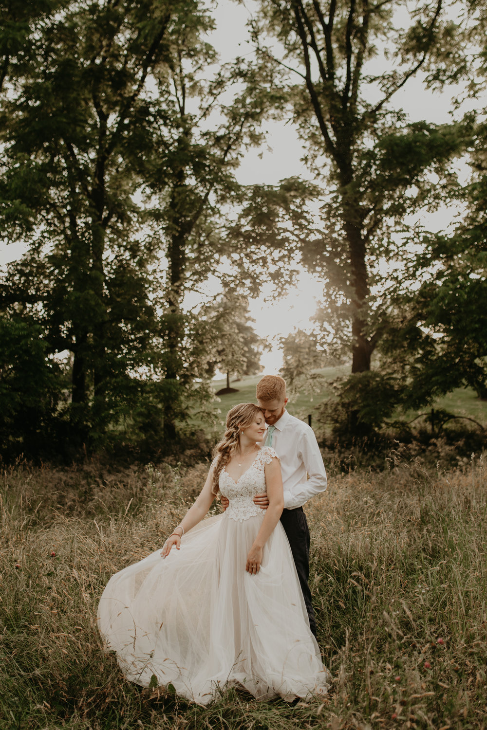 Nicole-Daacke-Photography-pennsylvania-laid-back-outside-backyard-wedding-family-summer-june-maryland-barefoot-bride-woodland-trees-sunset-couple-79.jpg