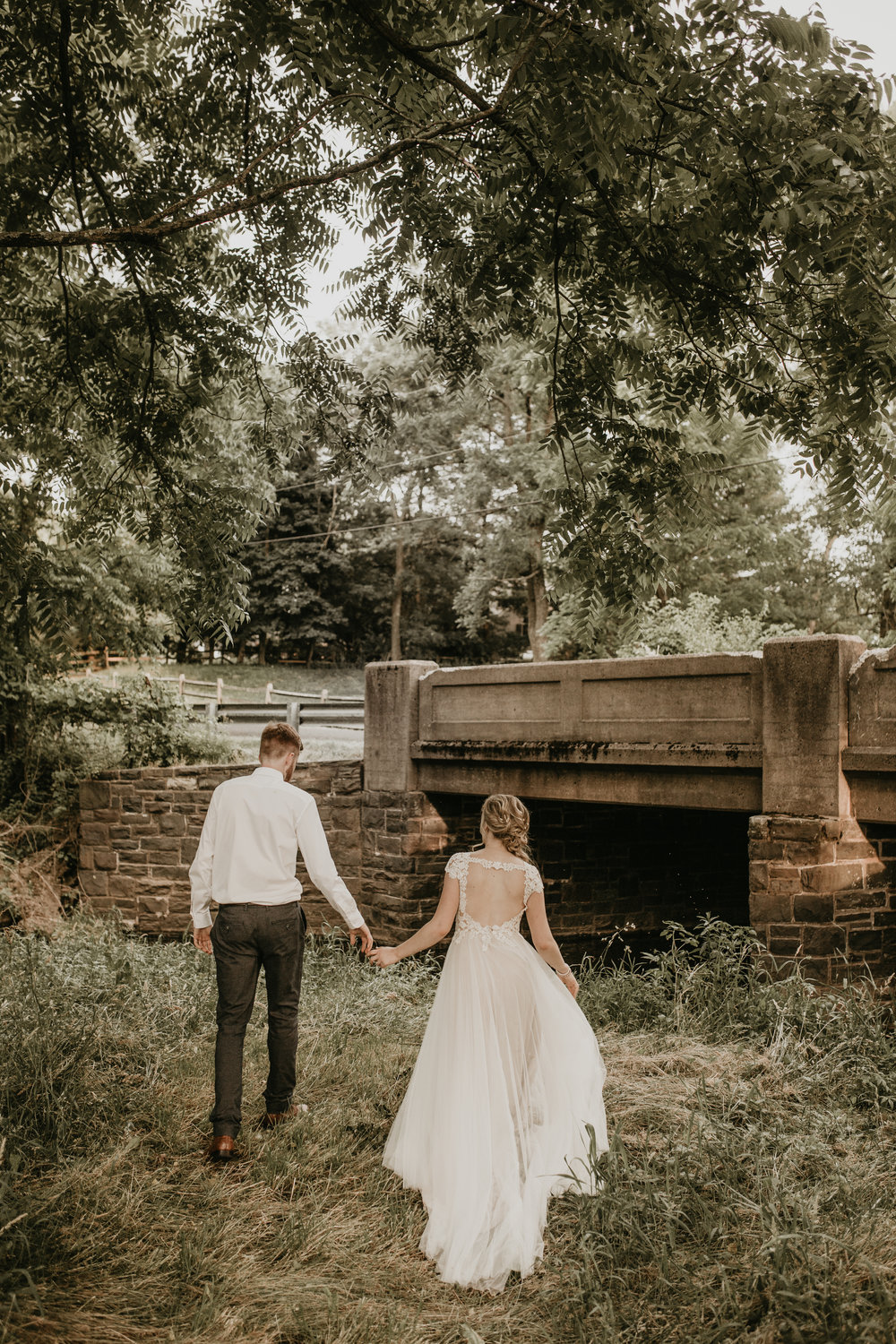 Nicole-Daacke-Photography-pennsylvania-laid-back-outside-backyard-wedding-family-summer-june-maryland-barefoot-bride-woodland-trees-sunset-couple-83.jpg