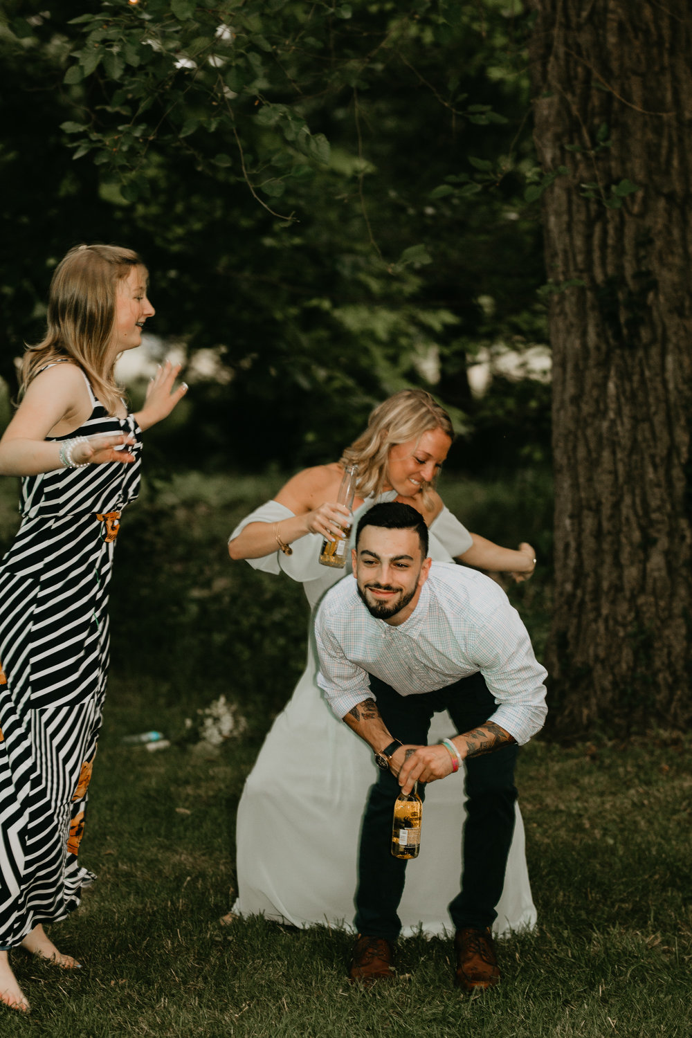 Nicole-Daacke-Photography-pennsylvania-laid-back-outside-backyard-wedding-family-summer-june-maryland-barefoot-bride-woodland-trees-sunset-couple-94.jpg