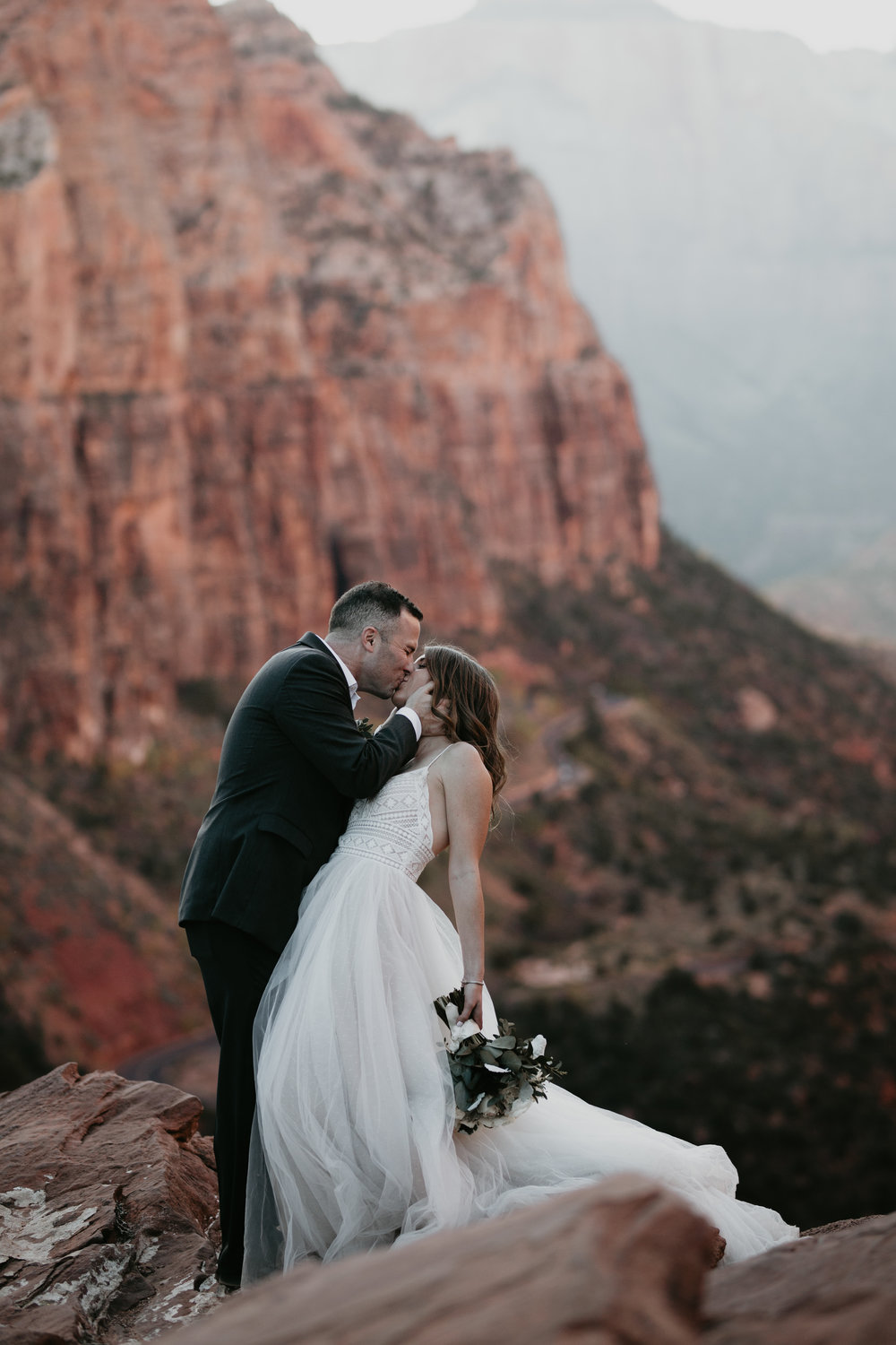 zion-national-park-elopement-photographer-adventure-adventurous-elopement-photographer-photography-in-national-parks-utah-red-rock-sunset-canyon-trail-destination-intimate-wedding-photos-20.jpg