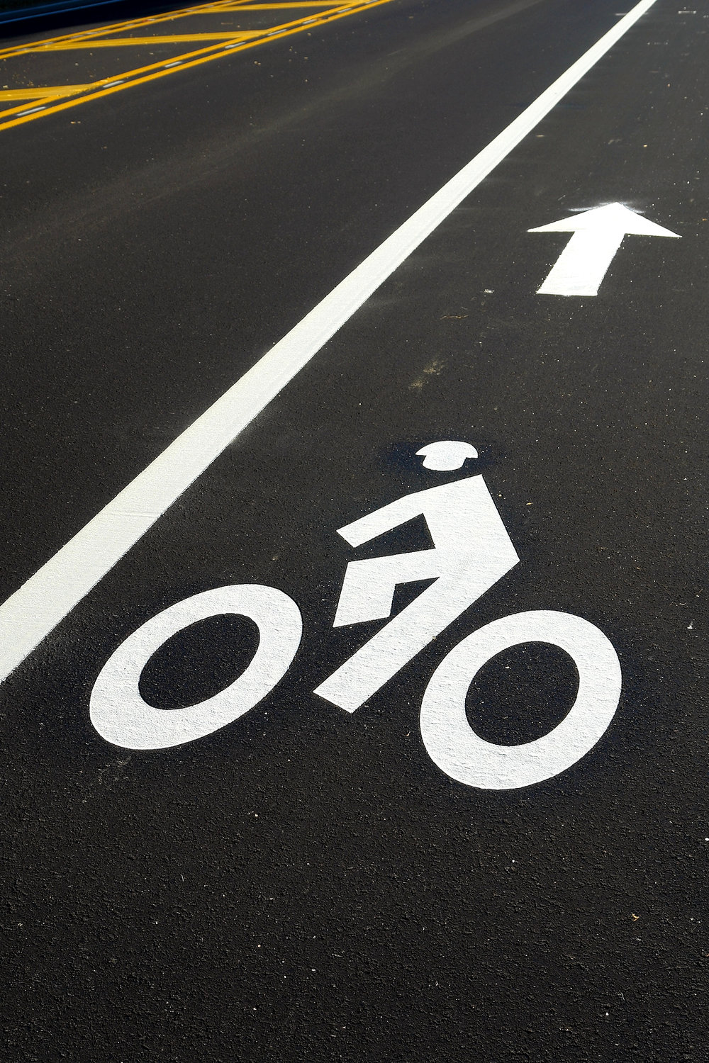 bigstock-Bicycle-Lane-On-A-New-Road-9256199.jpg