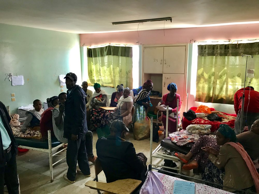 One of the busy pediatric wards. The young man in the bed to the left smiled at us and was well enough to get out of bed and follow us for a bit.